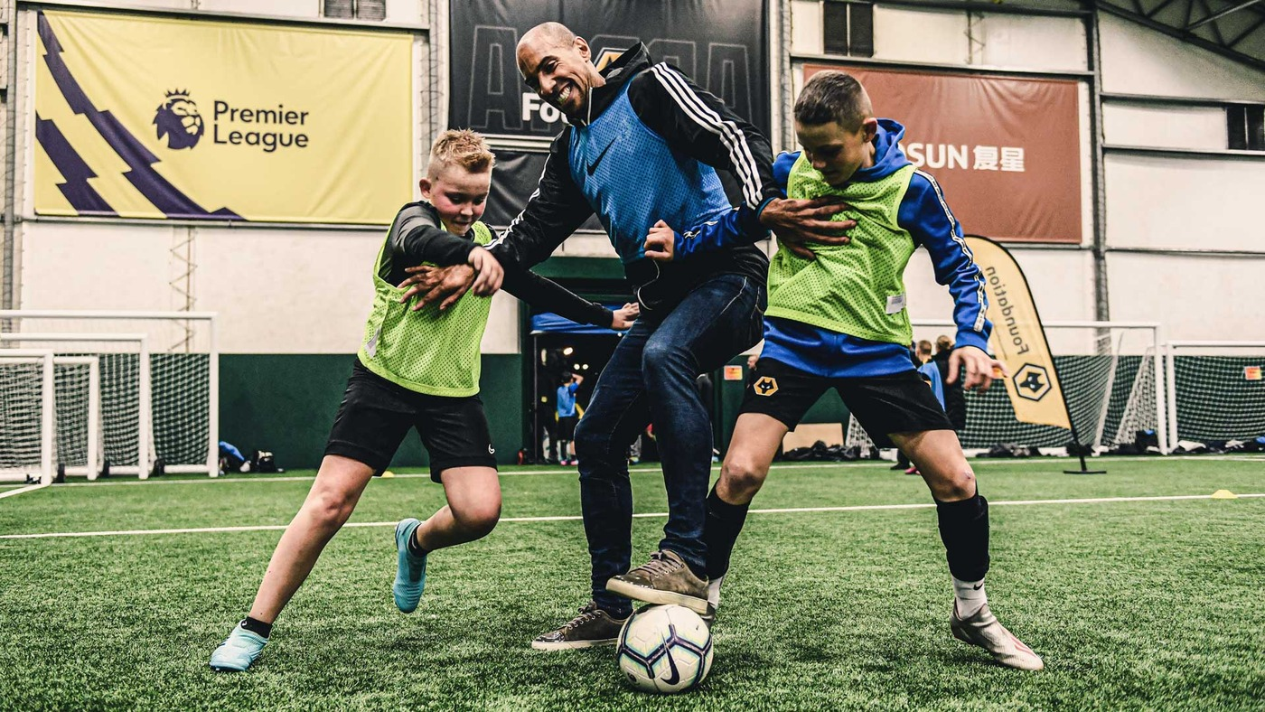 Jeff Shi, Kevin Thelwell, Karl Henry and S-X launch Premier League Kicks with the Wolves Foundation