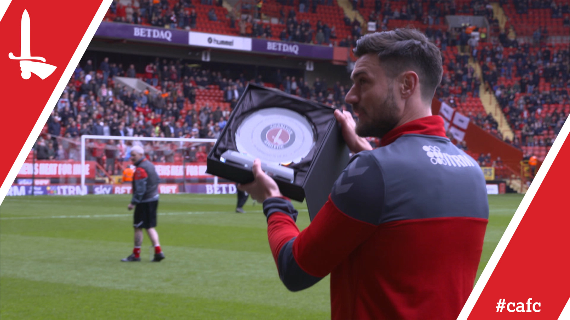 Johnnie Jackson receives a commemorative plate